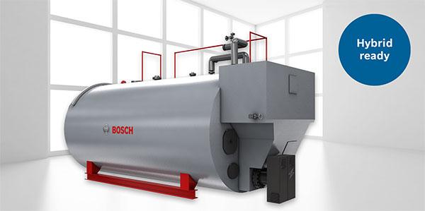 Hybrid-Kessel mit elektrischem Heizstab erzeugen bei regenerativem Stromeinsatz bis zu 5 MW CO2-neutrale Prozesswärme. Zusätzlichen Bedarf deckt der Brenner des Bosch-Kessels zuverlässig ab.